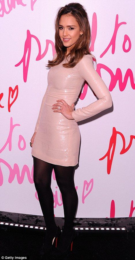 Pretty in pink: Jessica Alba glows in a pastel sequined mini dress for fashion awards