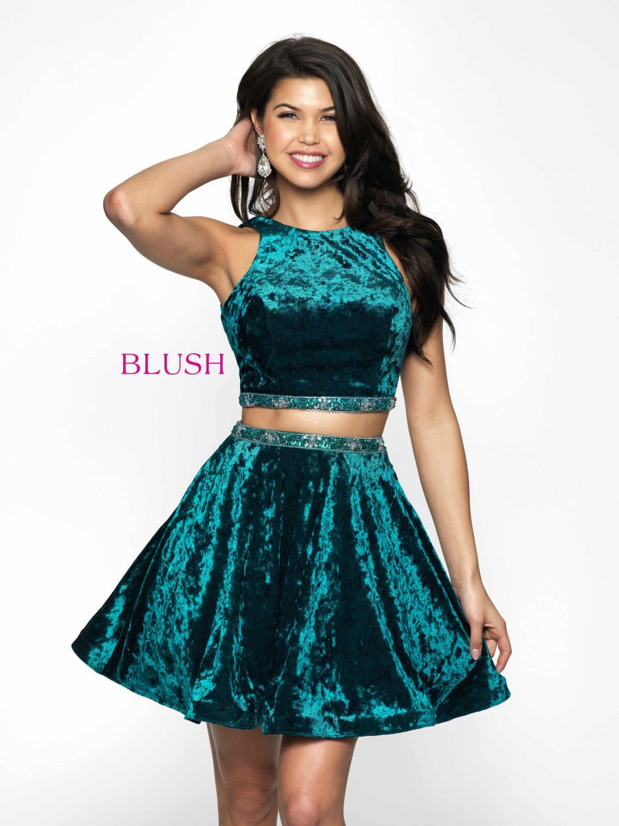 b7f6feba91d Blush 11625 is a two-piece crushed velvet homecoming dress with a high  neckline crop top and an A-line skirt with a beaded waistband.