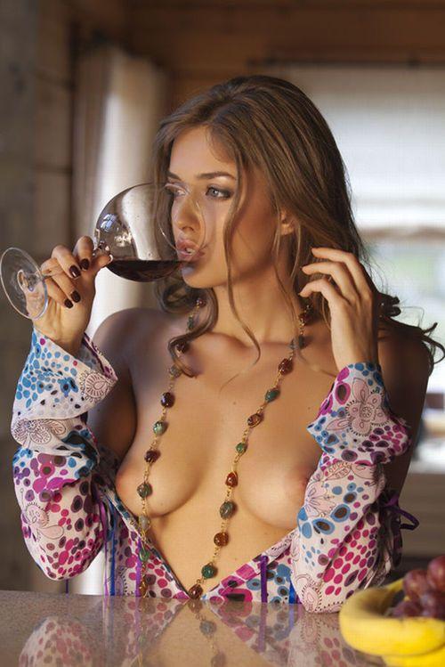 Naked girls drinking wine