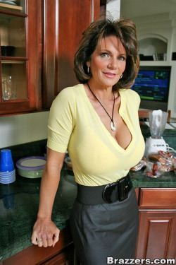 Busty Mature in the kitchen