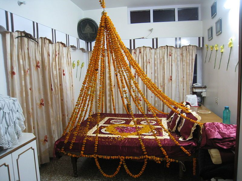 Flowerbed an indian ritual to the bride into her