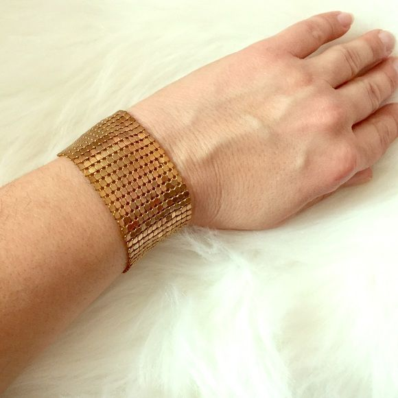 Wet Seal Gold Chain Mail Bracelet Gold chain mail shimmers like a disco ball in this fabulous bracelet. Close to 9 inches in length with an adjustable lobster claw closure, this bracelet is a party on your arm. 1 1/2 inch width. A great costume piece! Worn once; good condition. Wet Seal Jewelry Bracelets