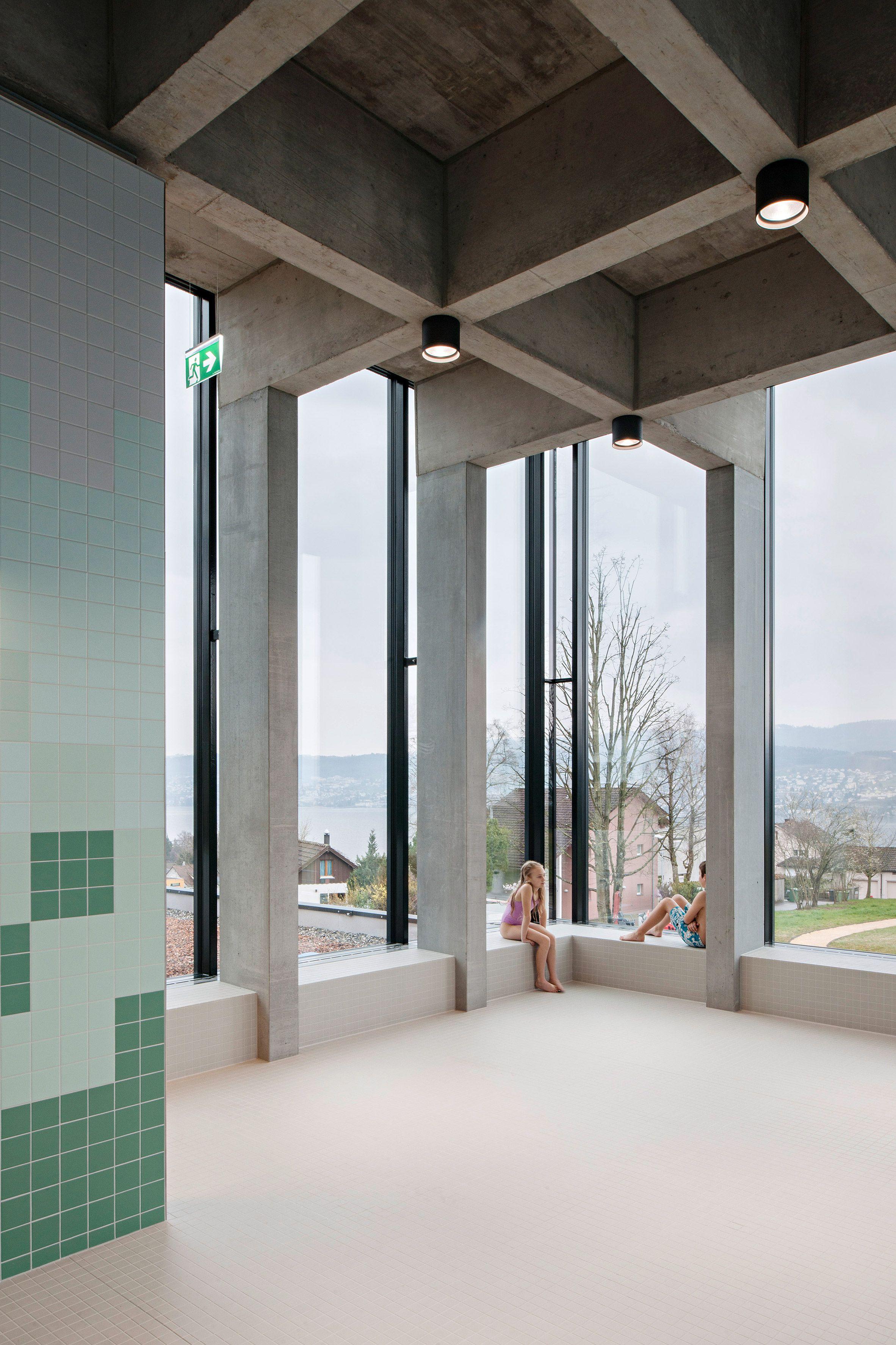 Frameless glass fin facade frameless glass sliding doors amp pool - Illiz Architektur Sets Children S Swimming Pool Above Former Underground Troop Billet In Zurich