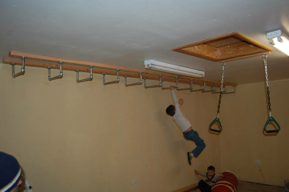 Monkey bars on ceiling indoor play space in
