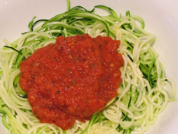 Raw zucchini noodles with sundried tomato and red pepper sauce.