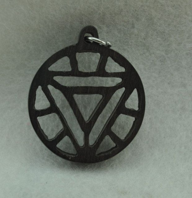 Ebony iron man symbol arc reactor pendant necklace superhero scifi ebony iron man symbol arc reactor pendant necklace superhero scifi harry potter dc marvel xmen lotr sci fi and fantasy exotic wood jewelry aloadofball Image collections