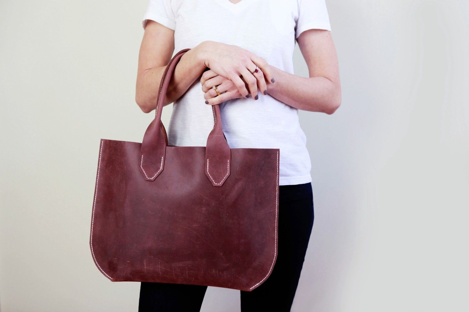Hand-stitched leather tote vs. Louis Vuitton tote?