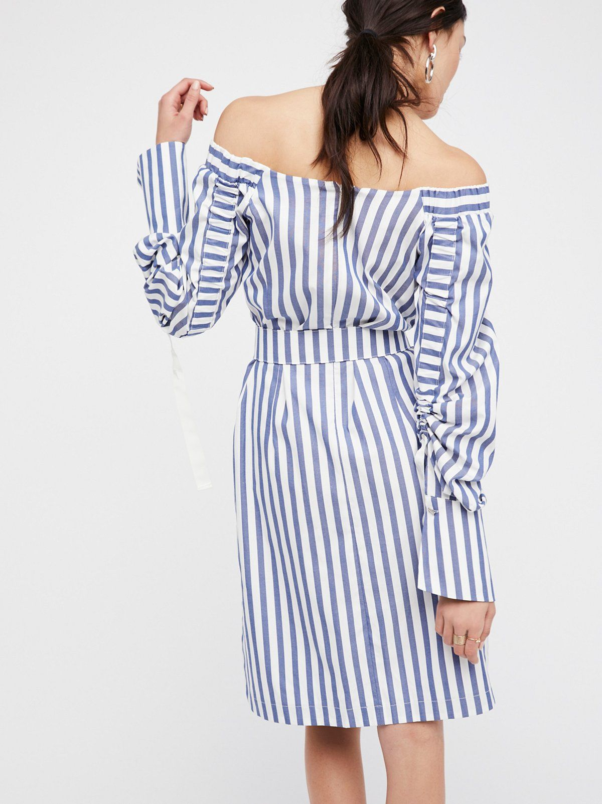 Seguar Dress | The classic striped dress gets a modern update with this off-the-shoulder mini featuring a structured shape with femme, scrunched sleeve details for added style.    * Elastic at the shoulders for an easy fit * Sleeve detailing adjustable with simple button closures * Side vents * Belt at the waist