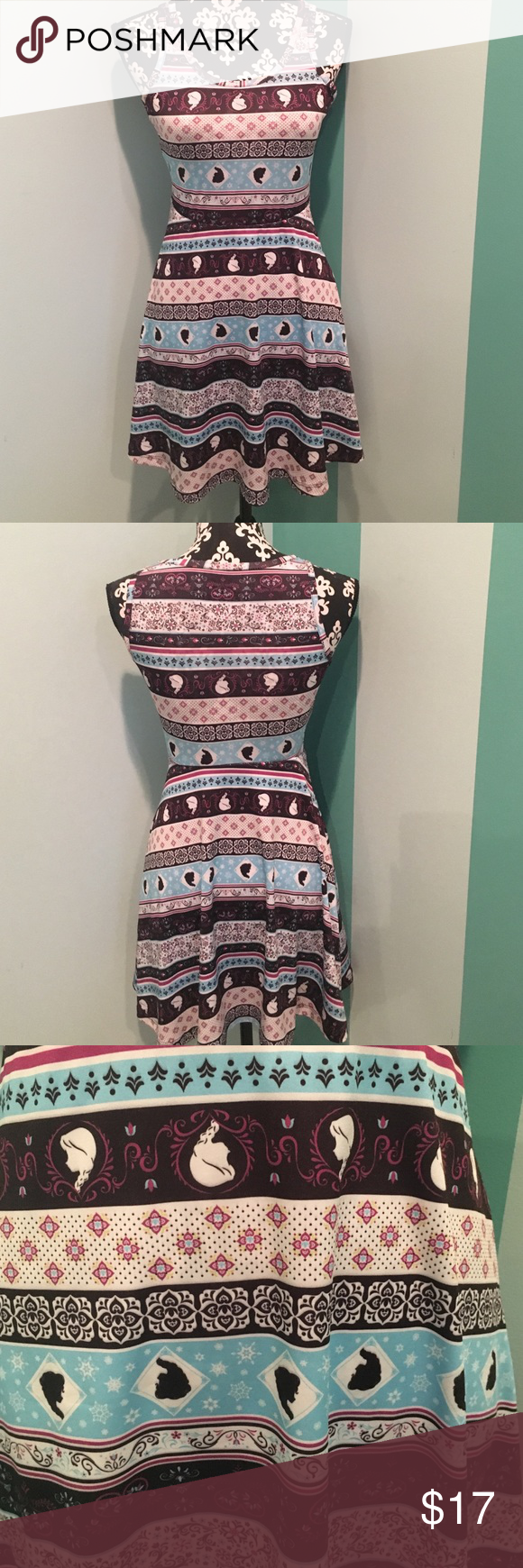 Fun and Adorable Frozen Dress! Show off your love of the movie Frozen with this fun and adorable dress! This dress is adorable and looks adorable on! Has a cute pattern on as seen in the picture! Have only worn once is in excellent condition and is need of a new home and to see the outside of a closet! Also with every purchase you get a free treat! 😀 Hot Topic Dresses