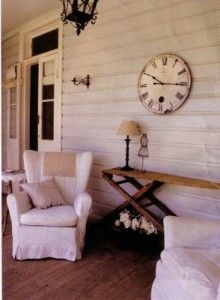 Love this country porch w/ the clock and ironing board!