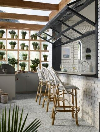 Bright and airy white kitchen green house with glass ceiling
