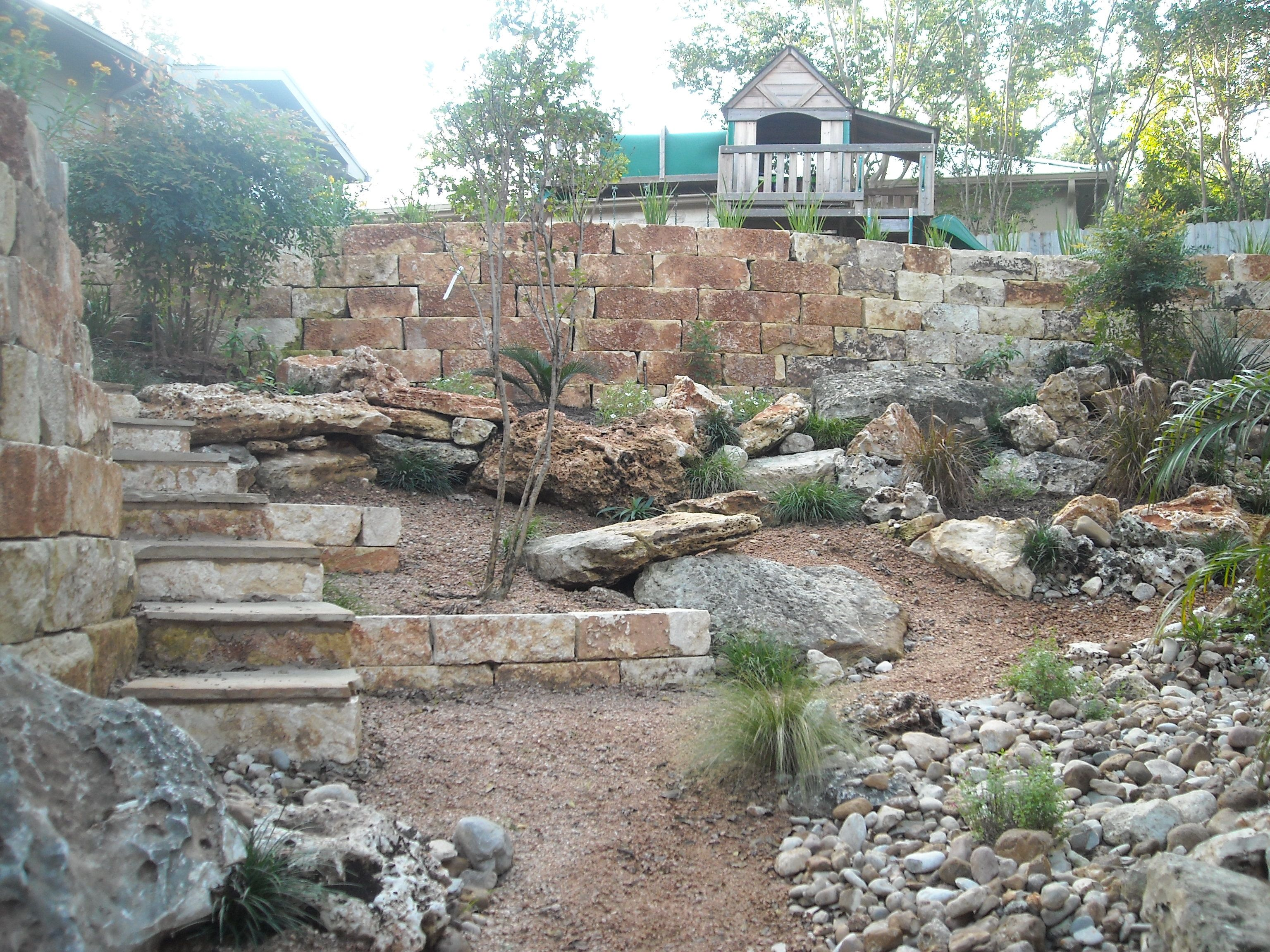 limestone retaining walls with limestone boulders to match
