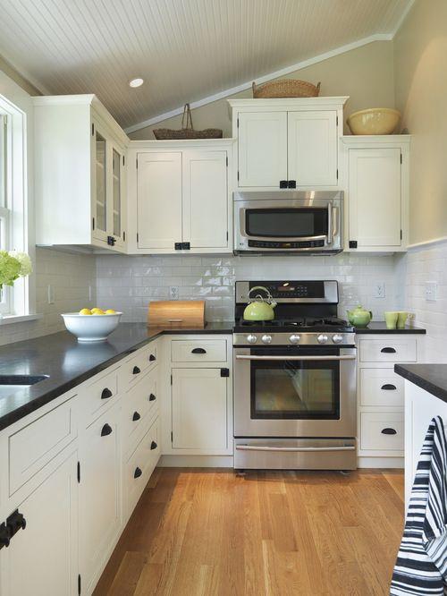 White Cabinets With Black Countertops Design Ideas Freestanding Kitchen Black Kitchen Countertops Kitchen Remodel Small
