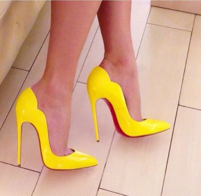 92903ff3adb9 Step into our sexy  Lola  yellow patent leather pump. The Lola pump features  a scallop side detail