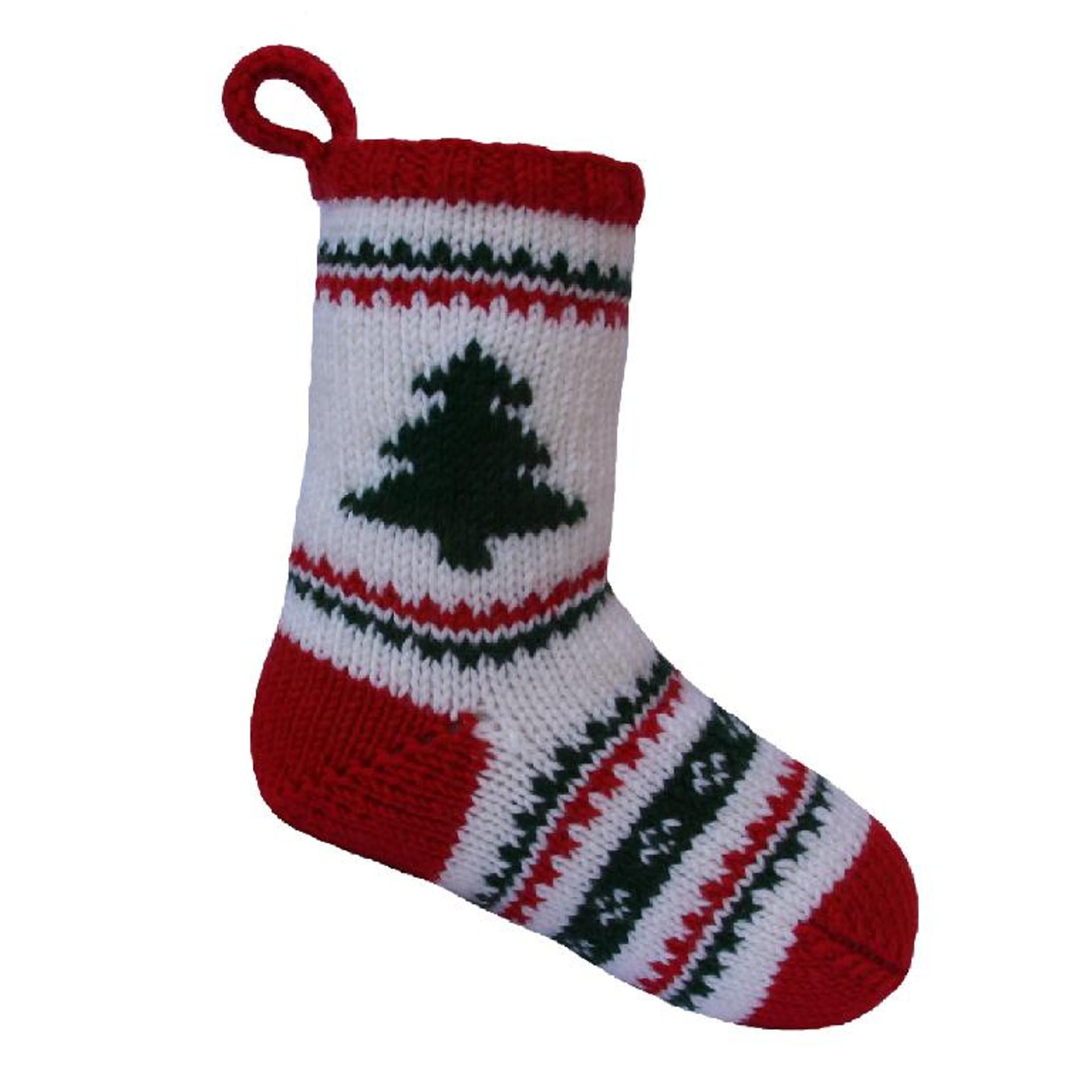 Free christmas stocking craftsy knitting patterns christmas free knitting pattern for christmas stocking with tree sarah gasson of knitables created this stocking that is approximately wide by long bankloansurffo Gallery