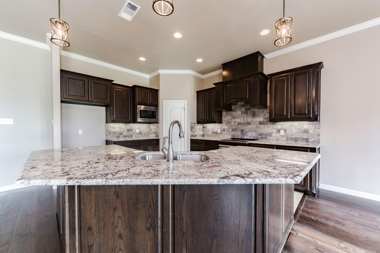 Dark Kitchen Cabinets With Light Counter Tops By Doug Parr Homes Boyd Tx Dark Kitchen Cabinets Dark Kitchen Kitchen Design