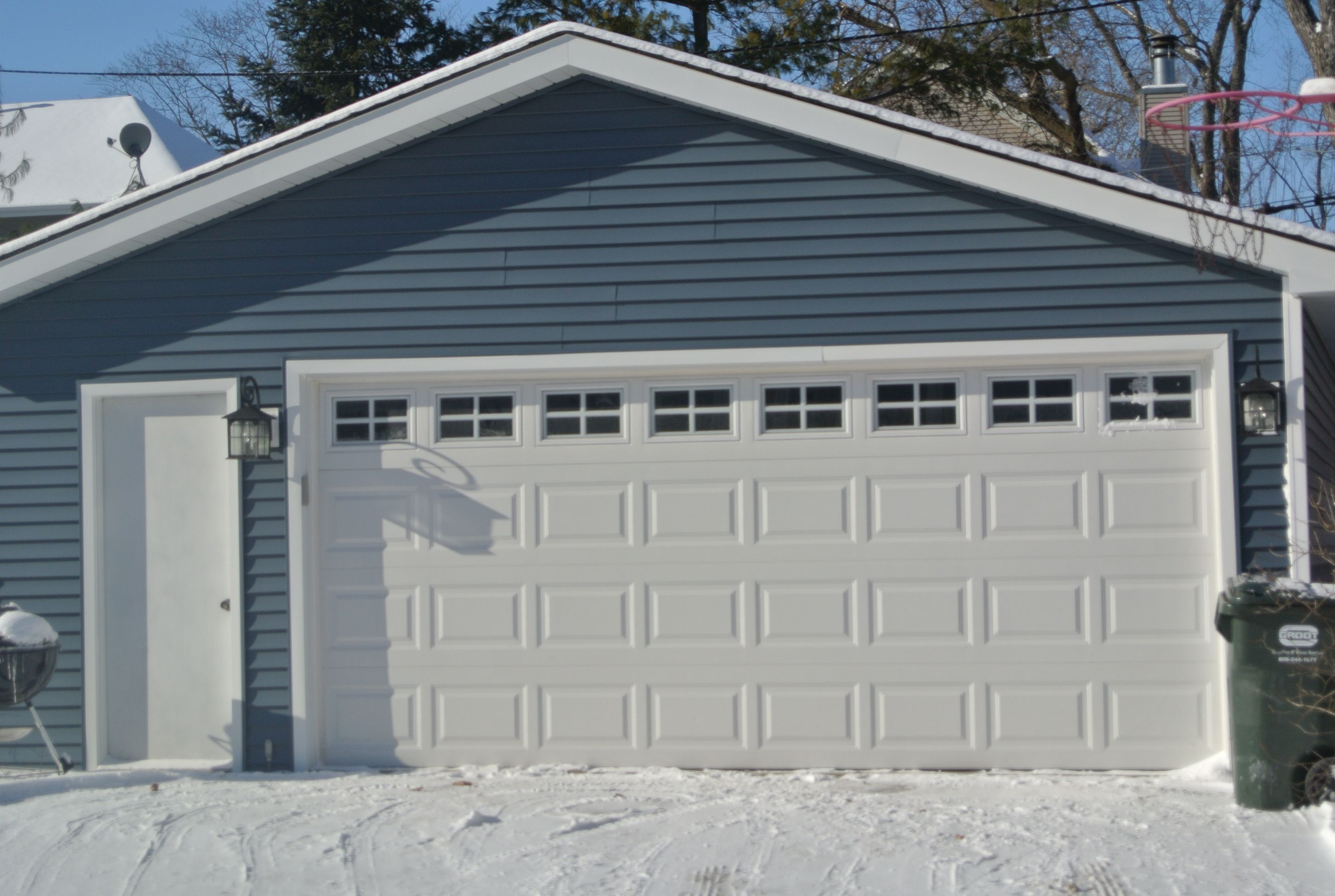 Pacific Blue Vinyl Siding By Certainteed I Like The Contract With The White Garage Trim Blue Siding House Exterior Blue Vinyl Siding