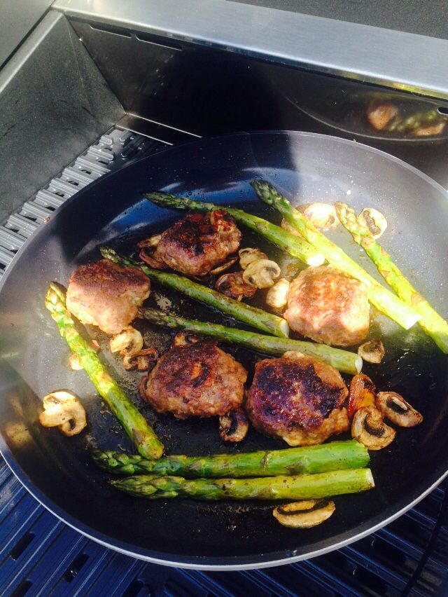 Lean beef mince patties with feta and tomato cooked with mushrooms and asparagus ,avocado oil on barbecue grill