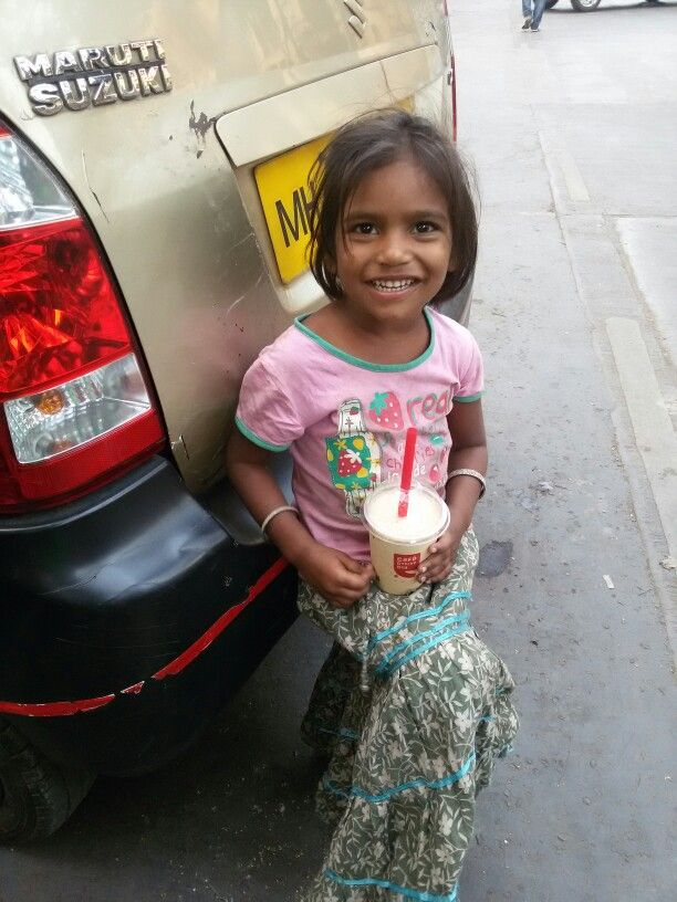 She said yaaaa it  taste good...saw her by the road side all smiling and happy to have her share of coffee....Happy Coffee Day