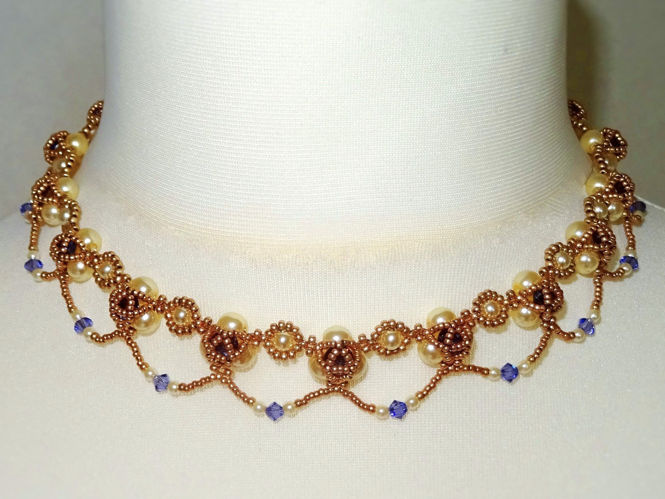Learn how to make this pretty necklace with glass pearls, crystal chatons, bicones and seed beads. The 19 page tutorial includes:* Introduction* Tips & information* Materials list* Step-by-step photos and instructions Please note:* You are purchasing the t...