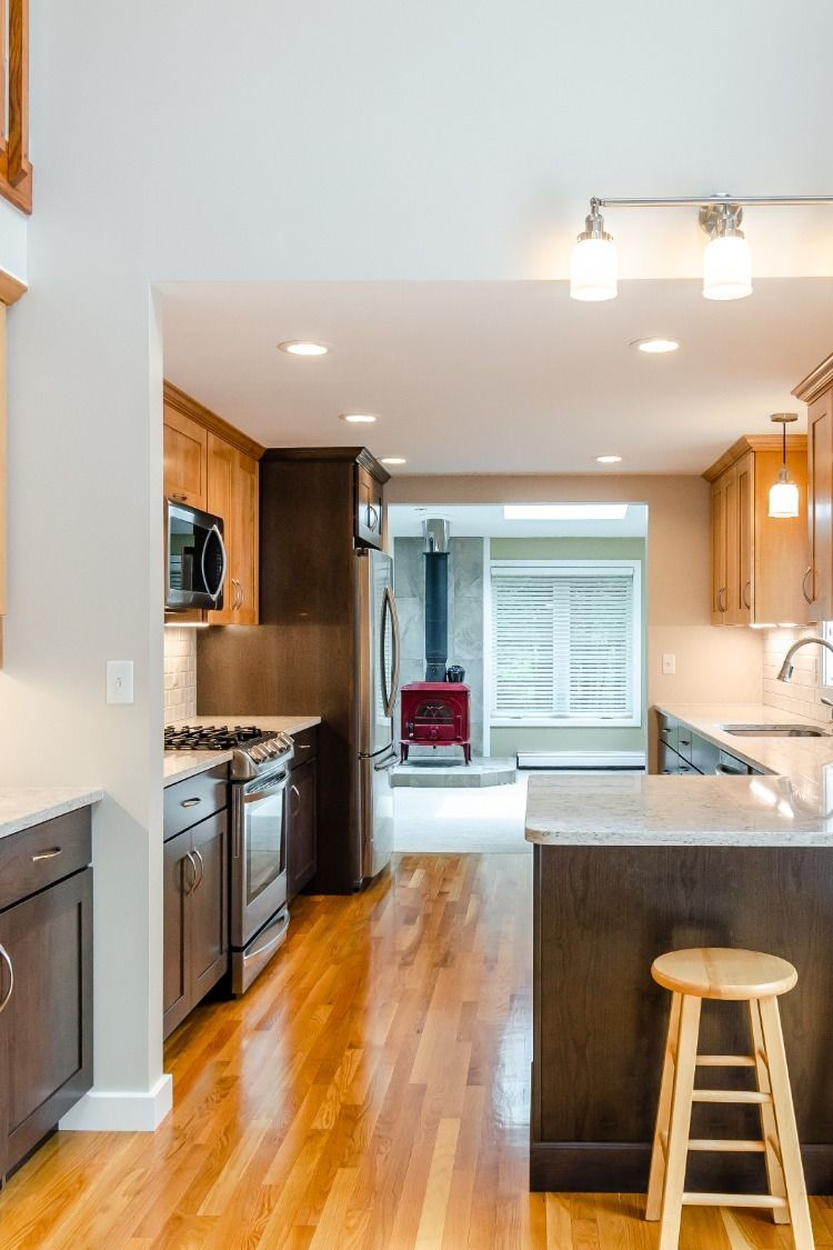 Mixed wood cabinetry, hardwood flooring, open plan ...