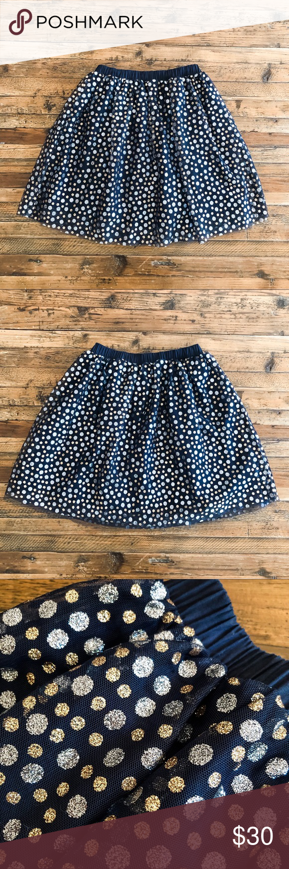 Crewcuts Tulle Skirt Crewcuts Tulle Skirt with Glitter Dots. Gold and silver sparkly dots on navy mesh over navy cotton/poly skirt. Elastic waist. Fully lined. Style No: J7259. Hits above knee. Great twirling skirt! New without tags condition. Girls' Size 12 (Large).   Crewcuts Tulle Skirt Crewcuts Tulle Skirt with Glitter Dots. Gold and silver sparkly dots on navy mesh over navy cotton/poly skirt. Elastic waist. Fully lined. Style No: J7259. Hits above knee. Great twirling skirt! New without #twirlskirt