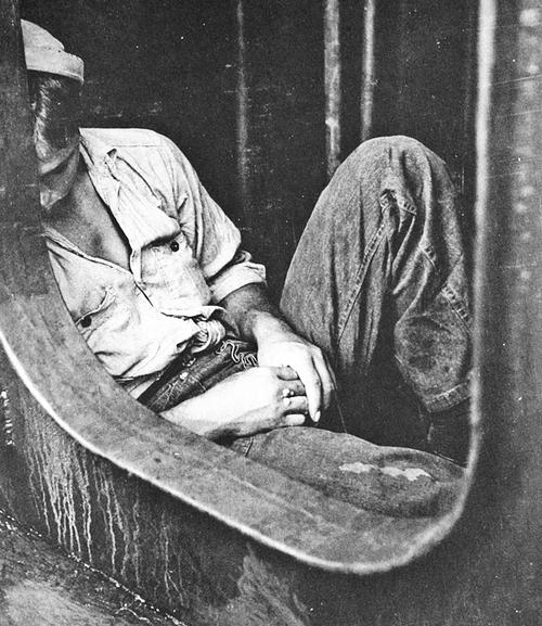 Sailor Sleeping Just Inside A Hatch On Board The Battleship New
