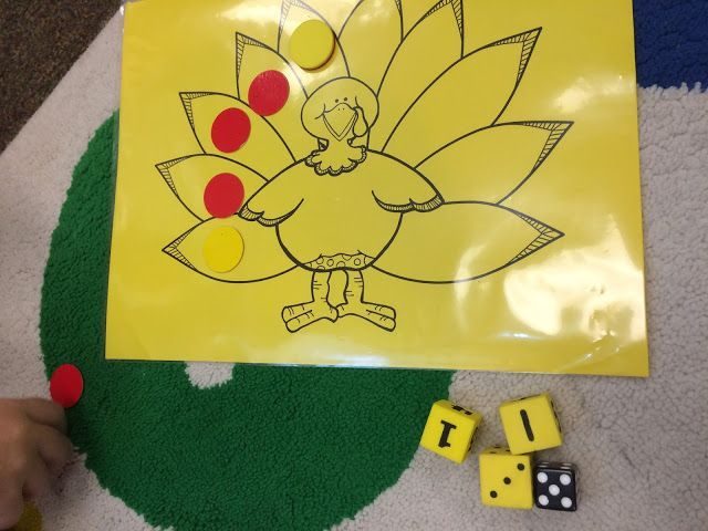 """A super fun """"make ten"""" math game. Each player needs a turkey board (provided) and counters. To take a turn a student rolls four dice. If he can make ten with any combination of dice he puts a counter on a turkey feather. The winner is the player who is first to cover all the feathers on his turkey or the player who has the most feathers covered at the end of game time."""