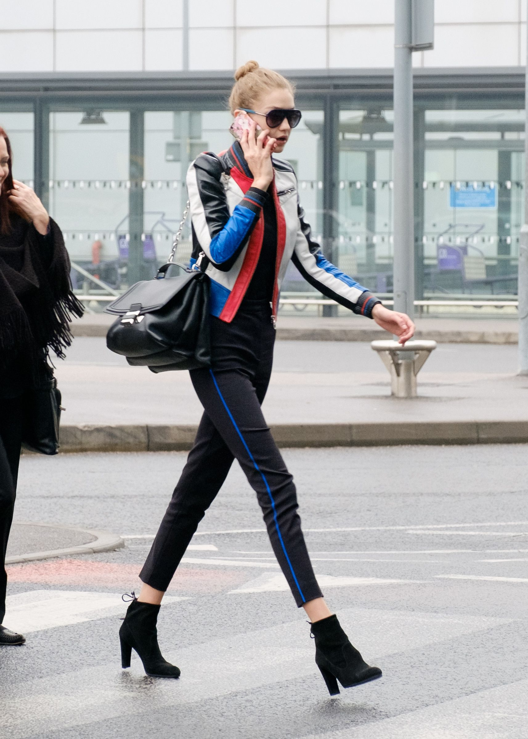 942b6d68094d5 The It-Girl Ankle Boots Gigi Hadid Wears to the Airport via  WhoWhatWear