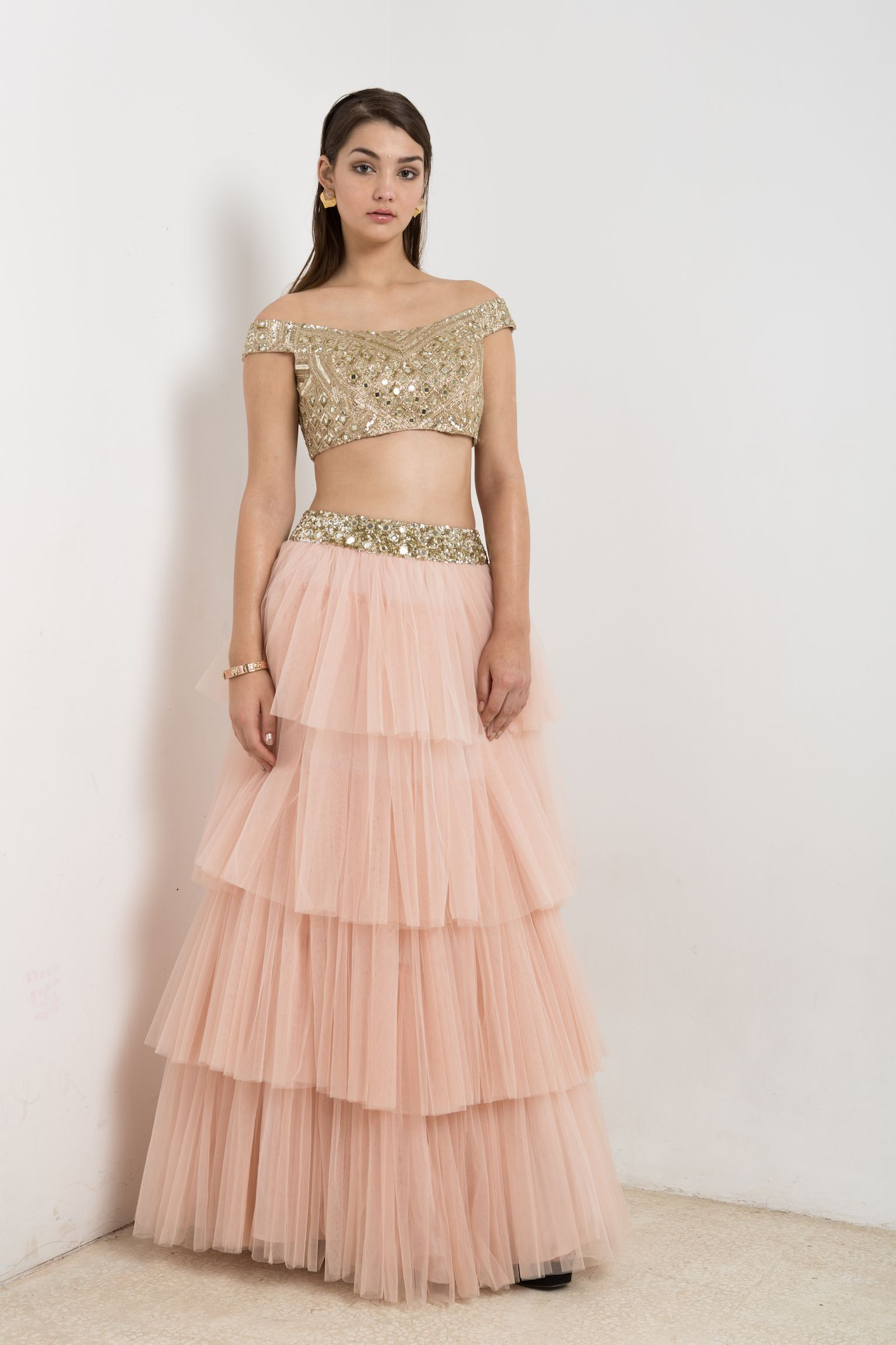 eab13d00a9ada7 Pink lehenga with tiers and mirror embroidery with a light gold mirror  embroidered crop top