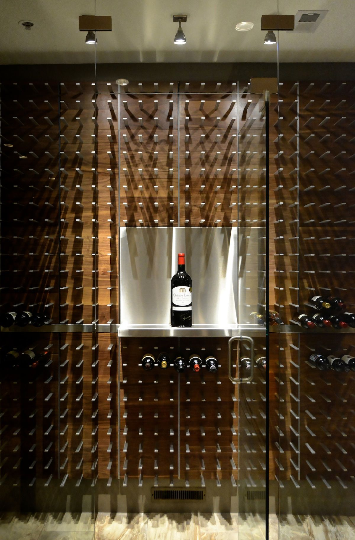 custom wall mounted wine cellar in temperature controlled glass with Magnum  display shelf