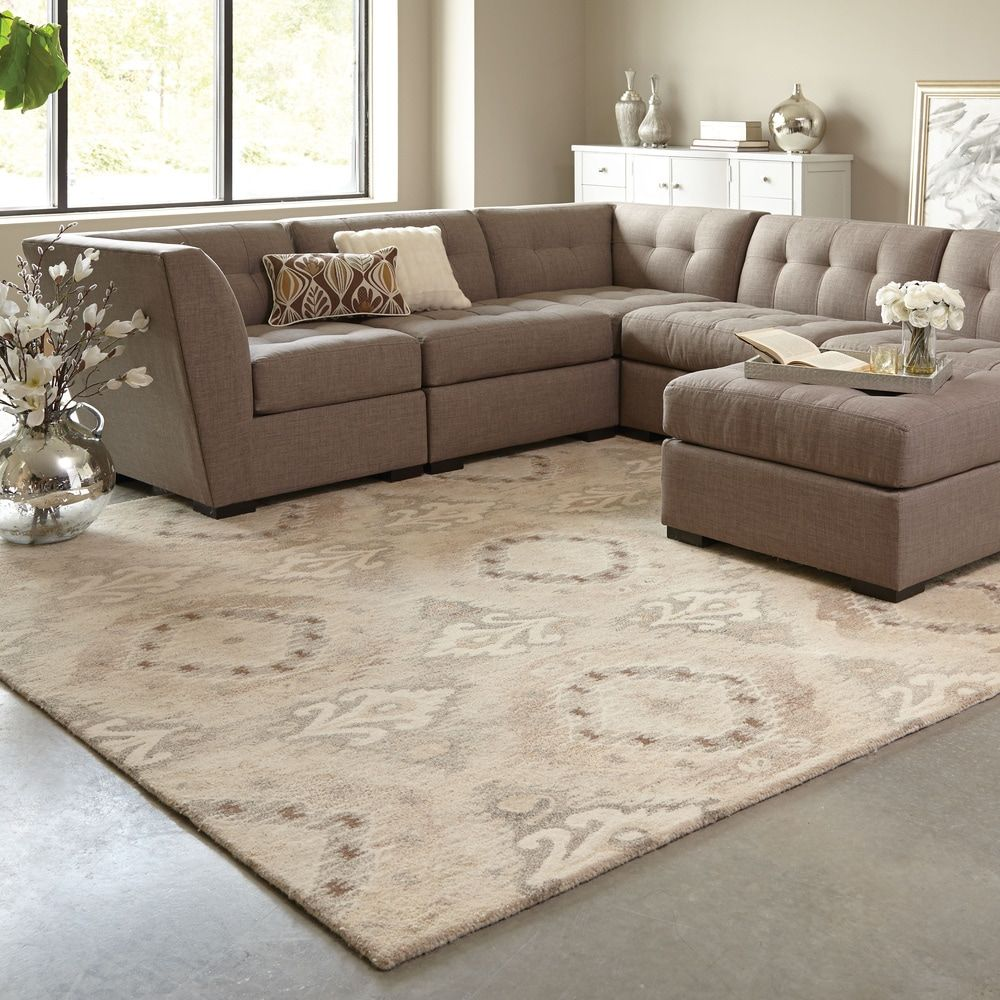 The classic geometric pattern and beautiful neutral colors of this Almirante area rug from Silver Orchid will instantly improve the appearance of your living room or bedroom. The Almirante is hand-tufted in India to ensure the highest possible quality and luxury. Features: Beige, ivory, and tan colors Transitional style Abstract pattern Hand-tufted in India Made of 100 percent wool Latex free .43-inch pile height Measures 8 feet wide x 10 feet long Tip: We recommend the use of a non-skid pad to