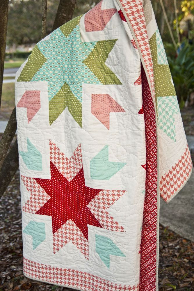 "by Lella Boutique (Vanessa Goertzen) Vanessa's ""Snow Blossoms"" quilt is a celebration of the Nordic snowflake seen in so many lovely wintry textiles. Fat-quarter friendly!"