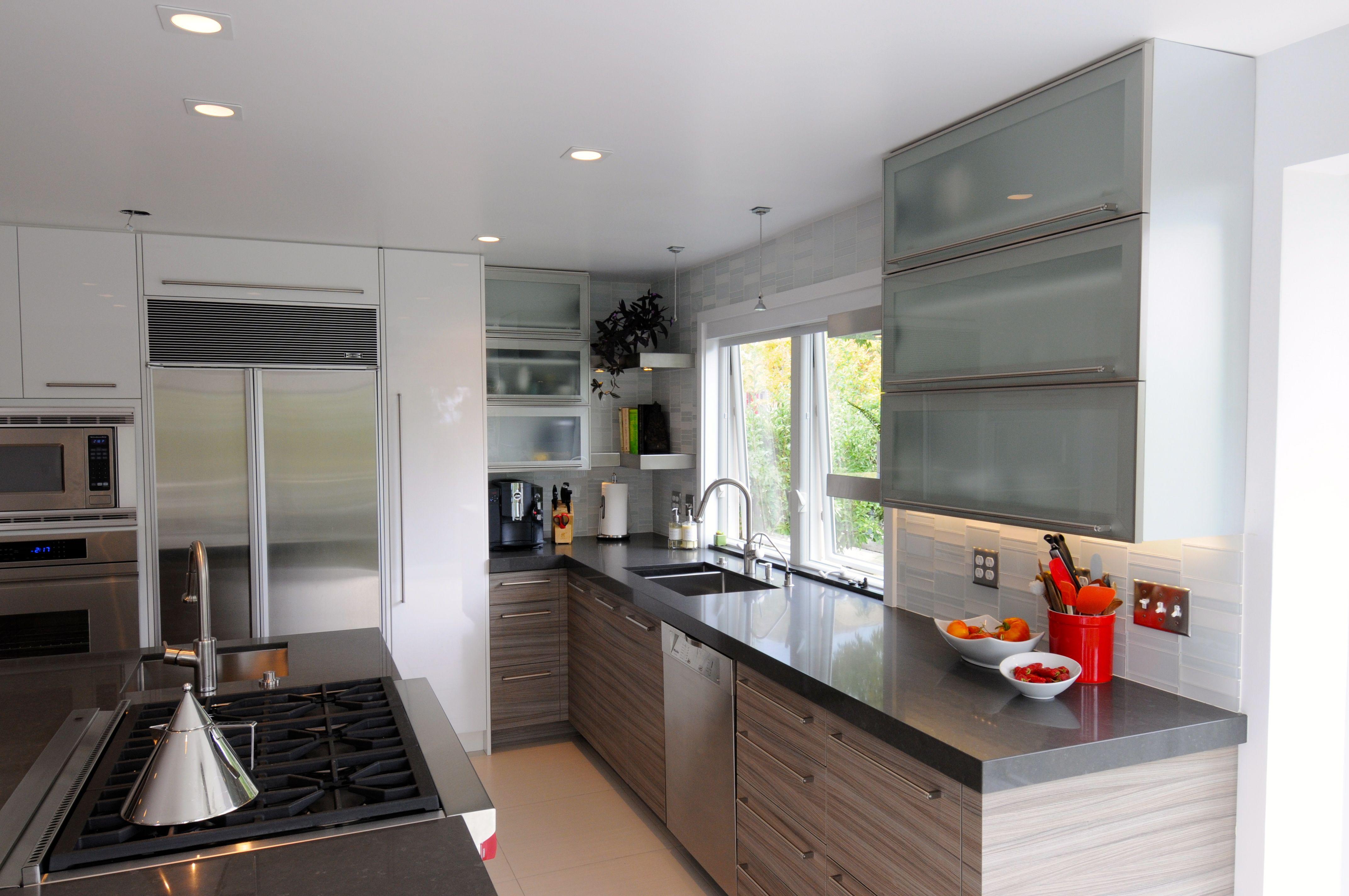 This Modern Kitchen has a mixture of Italian Laminate High Gloss