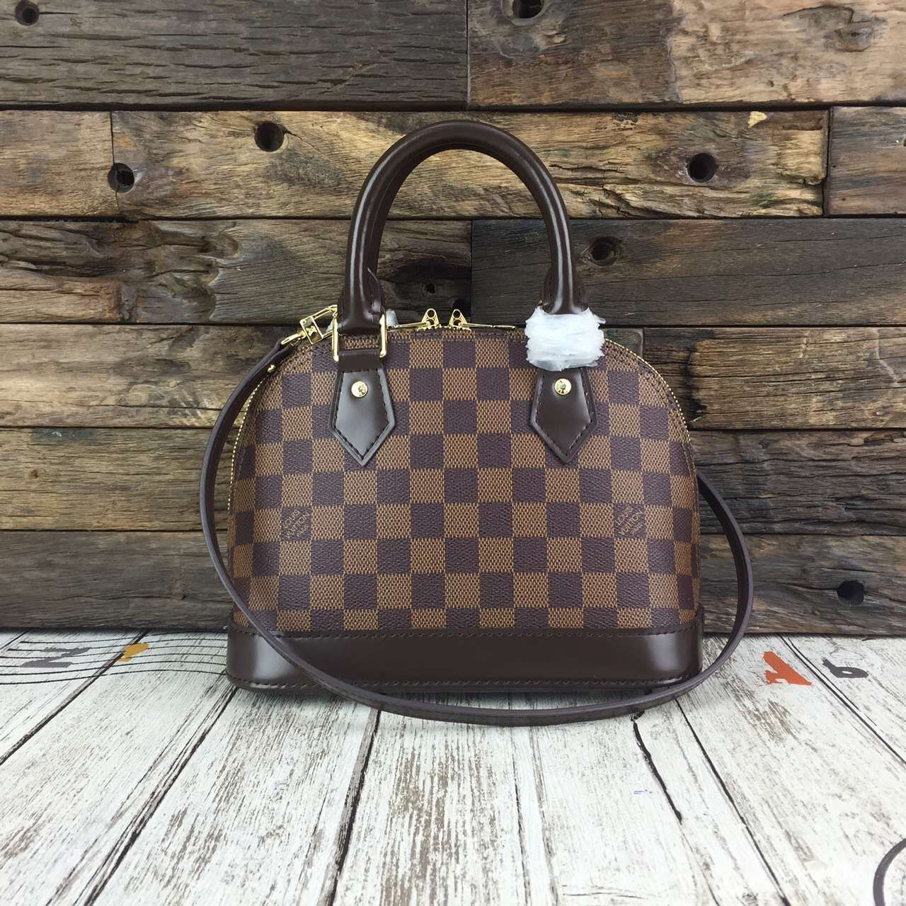 ef715fc4a403 Louis Vuitton Damier Ebene Canvas Alma BB N41221