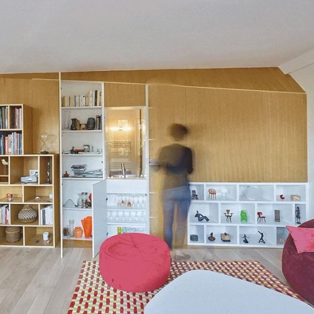 Concealed storage cabinets create a space-saving solution inside this apartment in Sceaux, which was recently overhauled by French studio h2o architectes. Find out more on dezeen.com/interiors #interiors #interiordesign #apartment #France #storage
