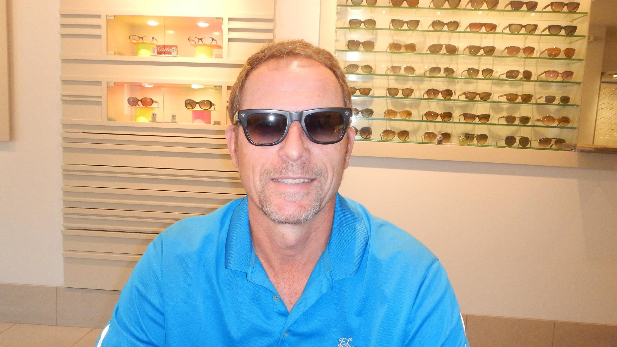 b55ecaf62e A happy customer wearing a pair of  ChromeHearts   sunglasses during a  fitting at Squint Eyewear in Oakville
