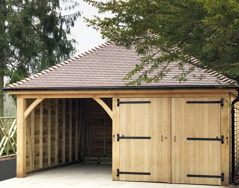 Single storey garage with open car port in light wood