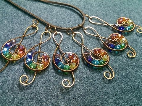 Photo of Musical note pendant with stones in rainbow colors – production of wire jewelry …