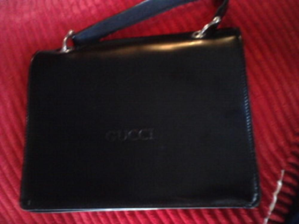A Gucci Black Patent Leather Purse for $200  VERY RARE AND ON THE CHEAP.    find at       http://style.ly/for_sale#!/gucci-mint-black-patent-leather-handbag--reduced-100-566686