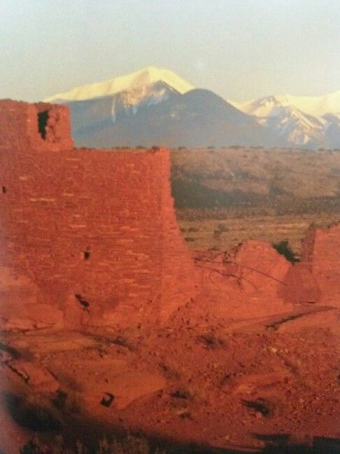 Wukoki Ruins at Wupatki National Monument in AZ. San Francisco Mountain Peaks in background
