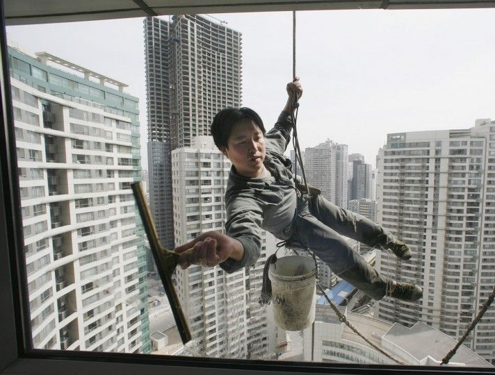 A Worker Cleans The Windows Of An Apartment Block In Beijing S Central Business District April 4 2007 Reuters Reinhard Krause