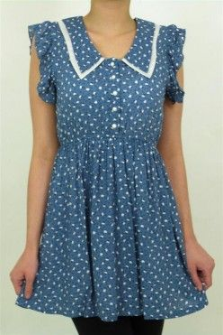 Woman's pointed collar patterned tea dress