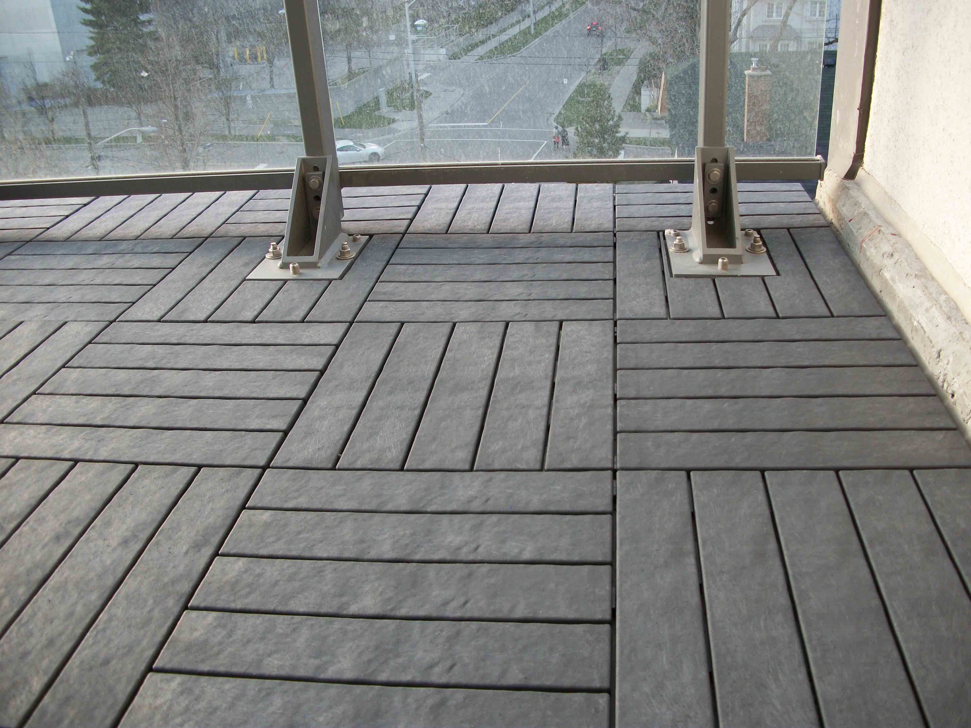 Charcoal grey floor decking tiles on balcony floor we supply and charcoal grey floor decking tiles on balcony floor we supply and install better dailygadgetfo Gallery