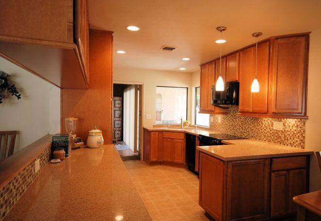 Kraftmaid Maple Praline Cabinets With Zodiaq Alpha Brown Countertops And Kitchenaid Black Appliances Kitchen Design Kitchen Cabinets In Bathroom Kitchen Redo