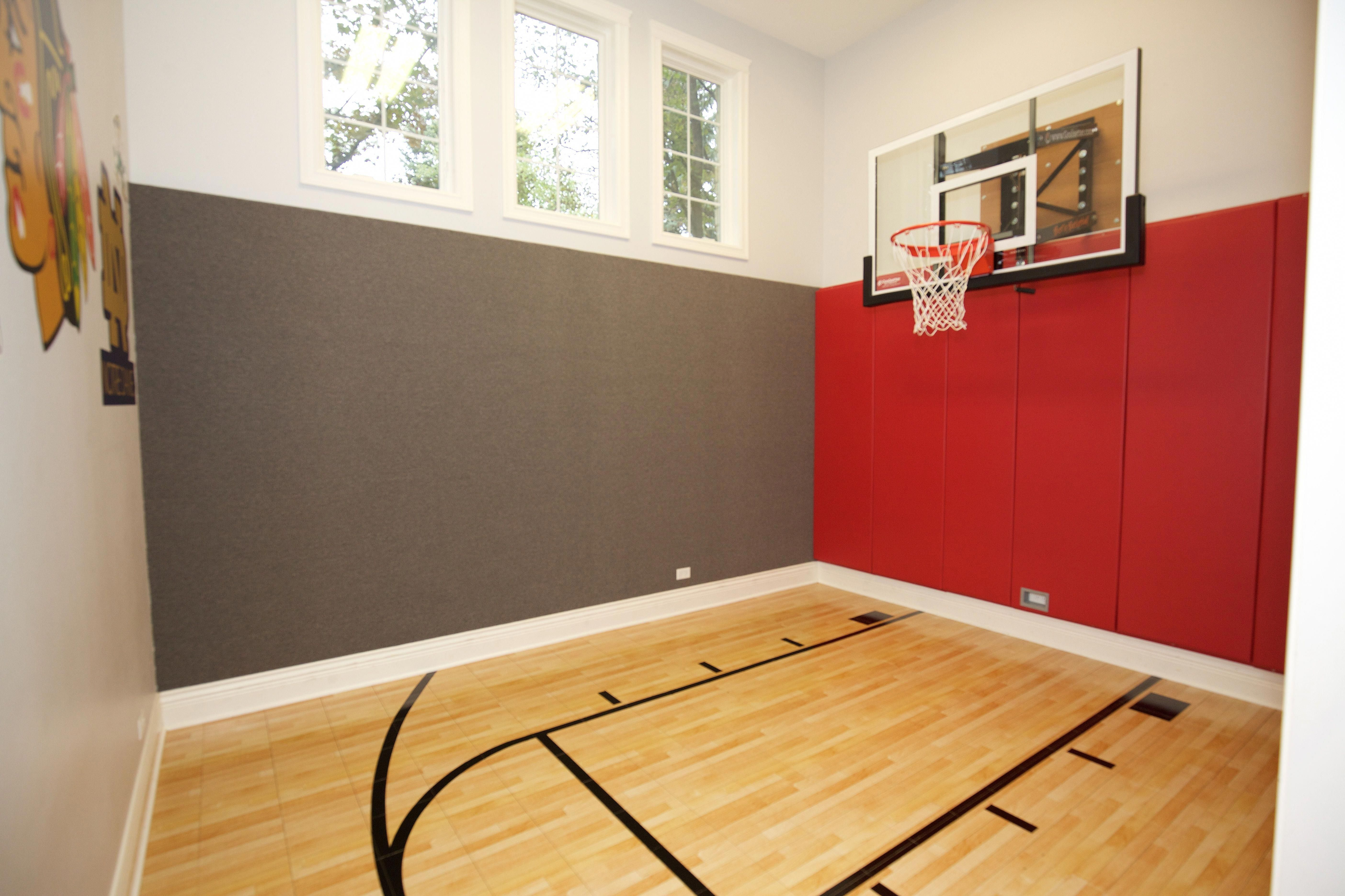 All The Kids Will Want To Come Hang Out At Your House With This Basketball Court In Your Basement Basketball Room Home Basketball Court Indoor Basketball Court