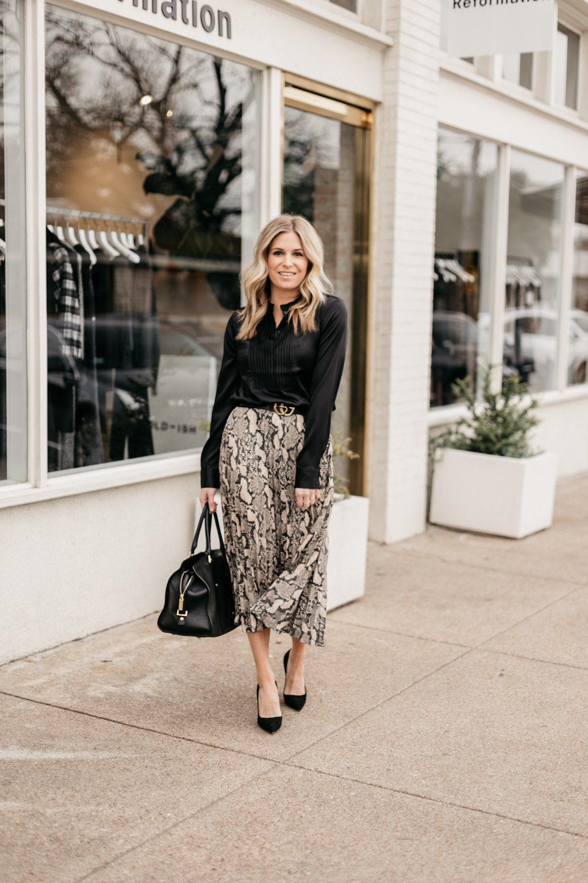 23edf6375 Sometimes the perfect work outfit is a skirt and a black blouse. I'm  sharing 5 ways to wear animal print for work on onesmallblonde.com.