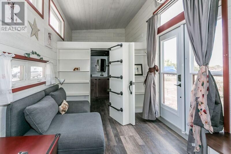 A two-bedroom tiny house for sale in Victoria Harbour, Ontario, with ...