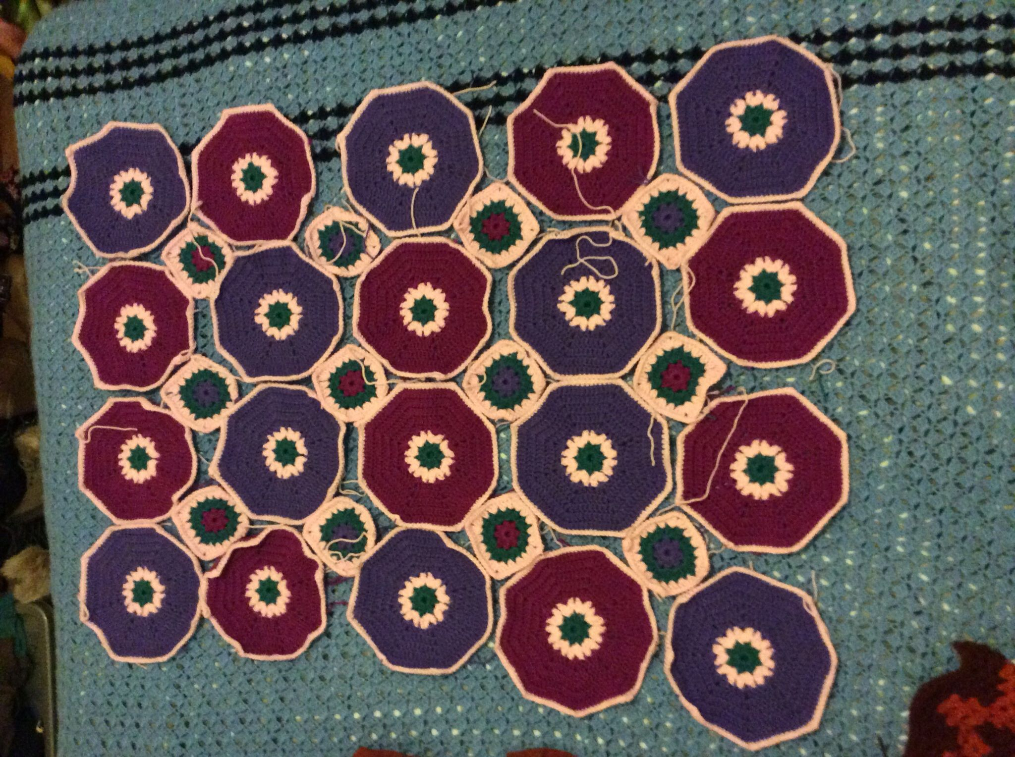 My almost done project, lapghan for moi! It's hexagons and squares, very pretty, lots of tails to work in tho which I hate!