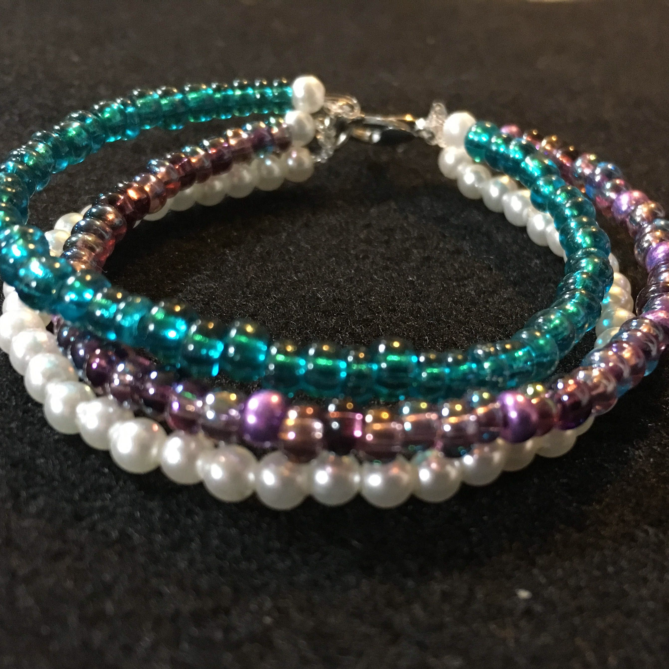 A personal favorite from my Etsy shop https://www.etsy.com/listing/510511668/triple-strand-multicolor-bracelet